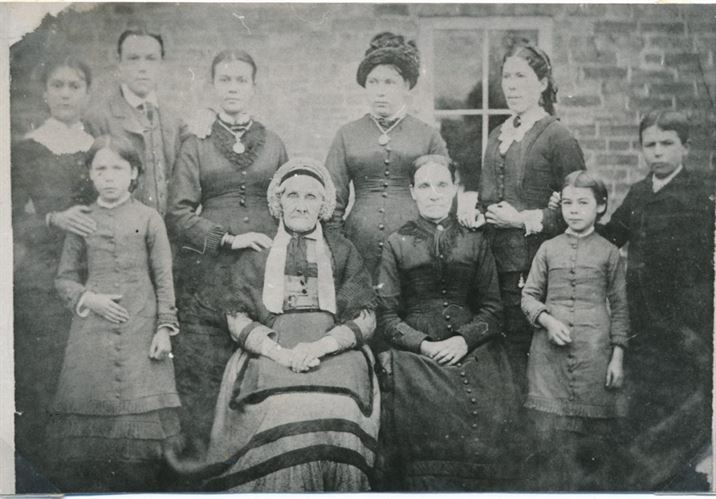 The Doubleday family outside Japonica Cottage (c. 1885)