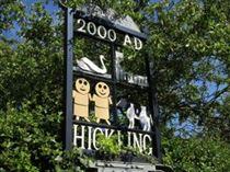 Millennium Village Sign