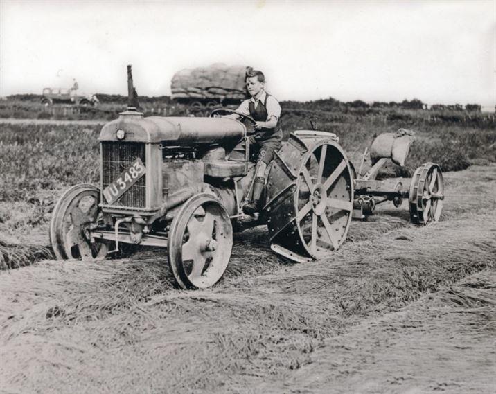 W1056 Boy on a tractor (1940s?)