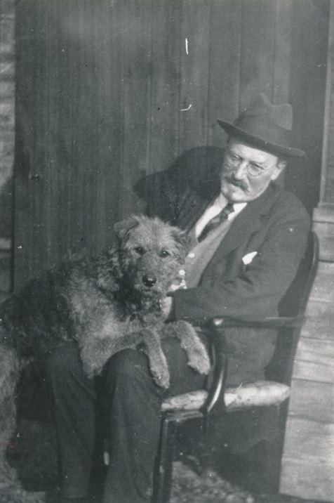 W1057a Mr JL Laws (headmaster) & his dog (1900s?)