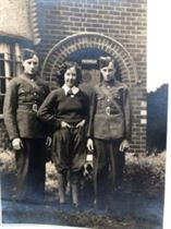 Marjorie Wright (land girl) & her twin brothers outsie their home in Nuthall