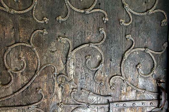 CG:: Medieval ironwork and C18th graffiti on the south door